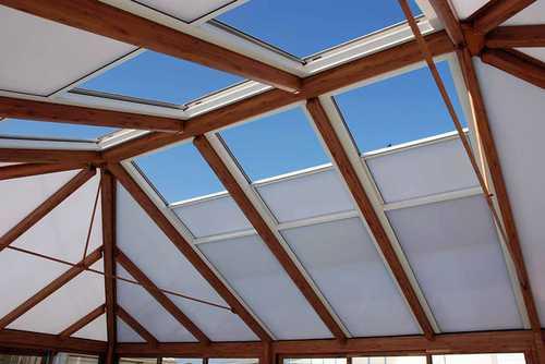 store blanc pour toiture veranda